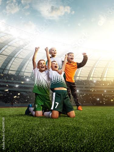 Fotografiet  winning football player Children after score in a match