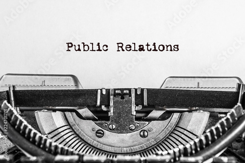 Fotografie, Tablou  Public Relations text typed on a Vintage Typewriter