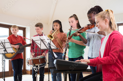 High School Students Playing In School Orchestra Together - 224703329