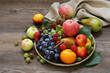 different berries and fruits on a wooden table