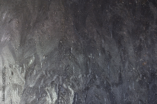 Photo  Black metal covered with ice as background