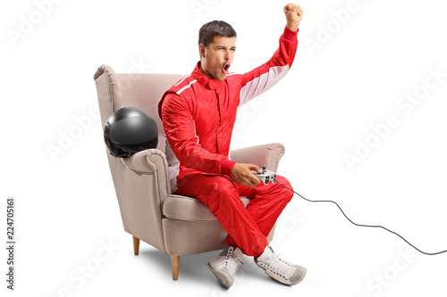 Racer sitting in an armchair, playing video games and gesturing with hand
