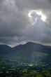 Beam of sunlight lights up the green and lush valley of Keswick England