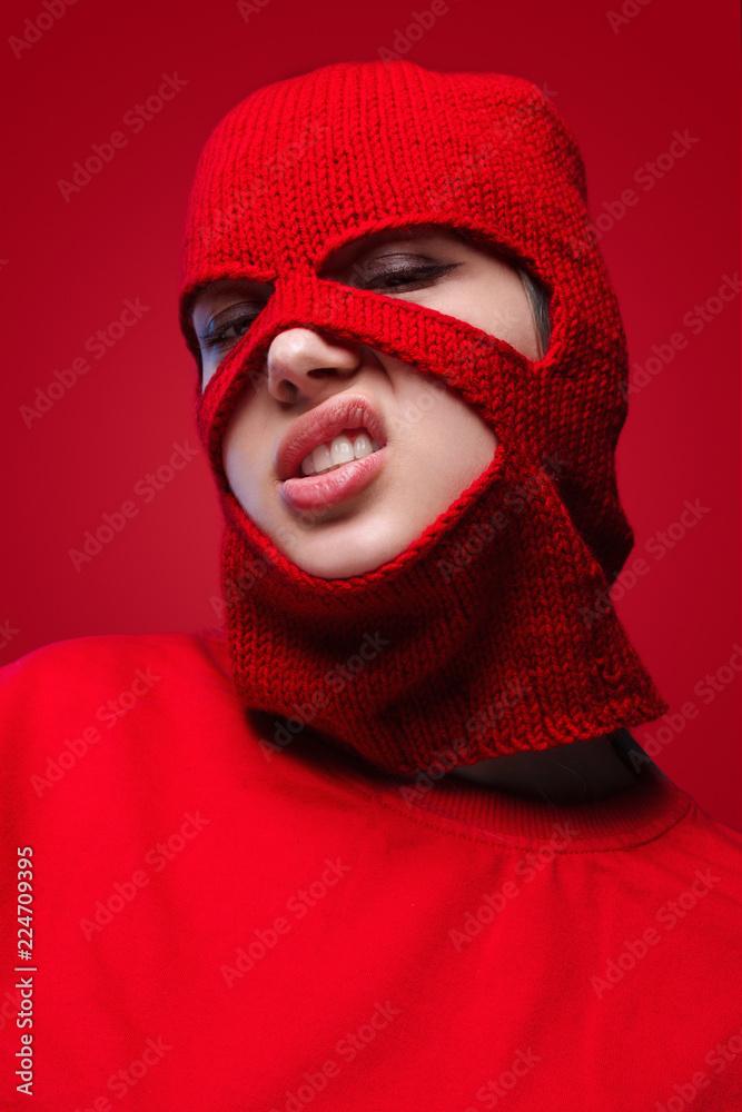 Fototapeta Displeased female in red mask