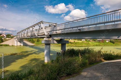 Spoed Foto op Canvas Brug panorama view near big huge bridge across river