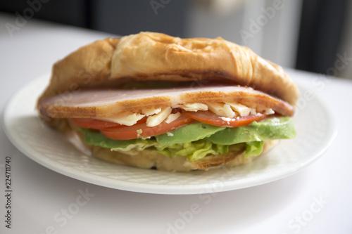 crossiant sandwich avocado, bacon, cheese, lettuce