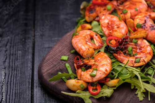 Aluminium Prints Seafoods Fried Prawns with pepper, garlic and lemon. Mediterranean cuisine. Asian cuisine.