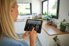 Woman At Home Using Smart Screen, Automation Domestic System