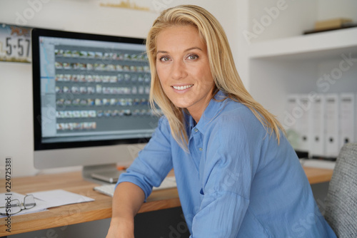 Portrait of blond woman working in office