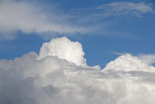 View On Puffy Rain Clouds In A Blue Sky