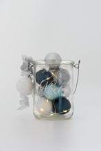 Christmas Lights, White, Silver, And Blue Balls In Glass Jar
