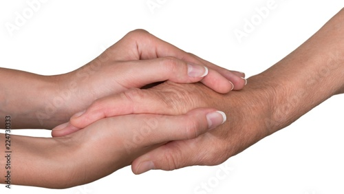 Fotografia Young Woman's Hands Touching and Holding an Old Woman's Hand