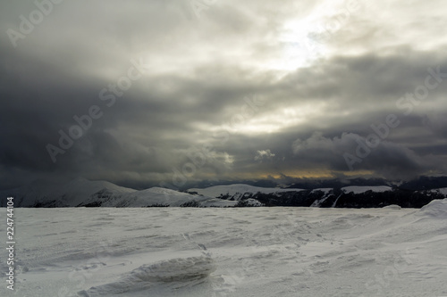 Fotobehang Grijs Winter mountain view in Carpathian mountains with dramatic clouds