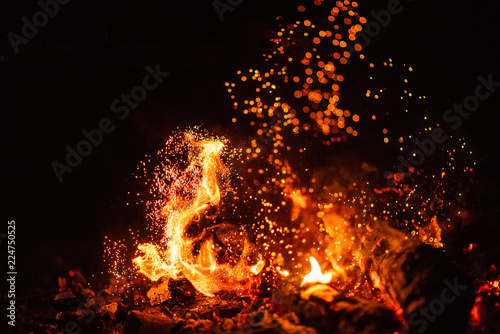Keuken foto achterwand Vuur Fiery fire isolated on black isolated background . Beautiful yellow, orange and red fire flame texture style.