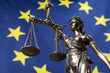 canvas print picture - Statue of the blindfolded goddess of justice Themis or Justitia, against an European flag, as a legal concept