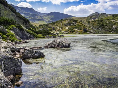 Poster Bergen Beautiful summer view to the seaweed surface of the Fish Lake, Ribnoto ezero at Seven Rila Lakes, Rila Mountains, Bulgaria