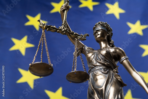 Statue of the blindfolded goddess of justice Themis or Justitia, against an Euro Fotobehang