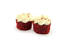 Two Red Velvet Cupcakes Isolated On White Background