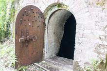 Old Metal Door To The Basement. Metal Door To The Cellar.