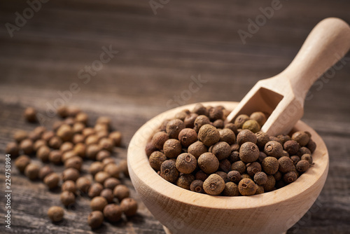 Tela Allspice on rustic background,selective focus.