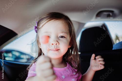 Fotografie, Obraz  Portrait of Little Girl with Red Lollipop