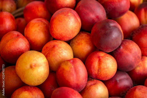 Fototapeta a beautiful fragrant ripe nectarine, the view from the top