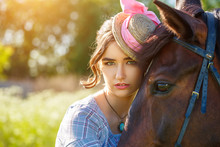 Portrait Of A Beautiful Young Woman With A Horse