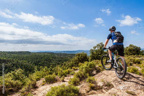 фотографія  Male ebike rider taking a break and enjoying the beautiful landscape