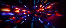 Neon Sparks On A Dark Background. Neon Light, Laser. Blurred Background. Abstract Dark Festive Background.