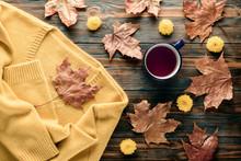 Autumn Fashion Seasonal Concept Sweater Cardigan Cup Hot Black Tea