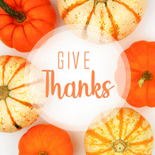Give Thanks Greeting Card With Frame Of Assorted Autumn Pumpkins Over A White Background