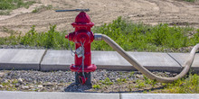 Fire Pump With Wrench On Top And Hose On Nozzle