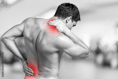 Stampa su Tela Strong man with neck pain, back view