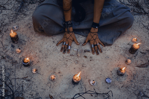 Fotografie, Obraz woman with candle deep in forest. Witch craft concept