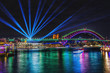 canvas print picture - Colorful projection lights above city in night