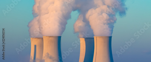 Cuadros en Lienzo  cooling towers with water steam in morning light, nuclear plant