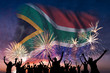 canvas print picture - People are looking on fireworks and flag of South Africa