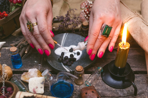 Fotografie, Obraz  Witch woman is preparing a magic potion on paranormal table background
