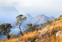 Blyde River Canyon, Three Trees, Blue Lake And Mountains In The Clouds In Sunset Light Background, South Africa
