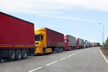 Queue Of Trucks Passing The In...