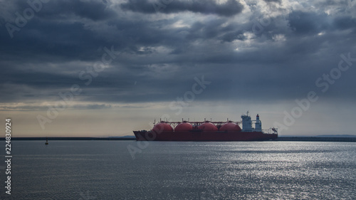 LNG TANKER - Rain and stormy dramatic clouds over a gas terminal in Swinoujscie