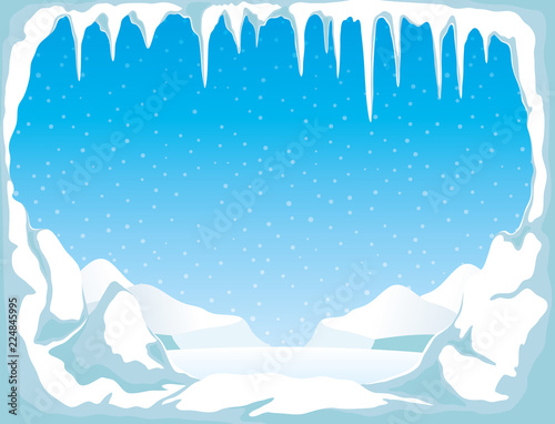 Ice with icicles and snow on a blue background. Fototapet