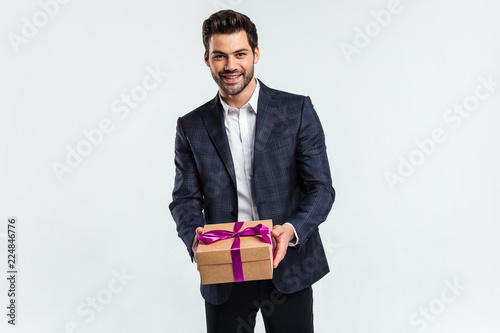 Your Birthday Gift Handsome Young Man Holding A Present Box And Looking At Camera With Smile
