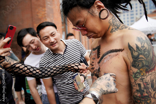 Angus Shen shows his body pierced by professional body artist Wei ...