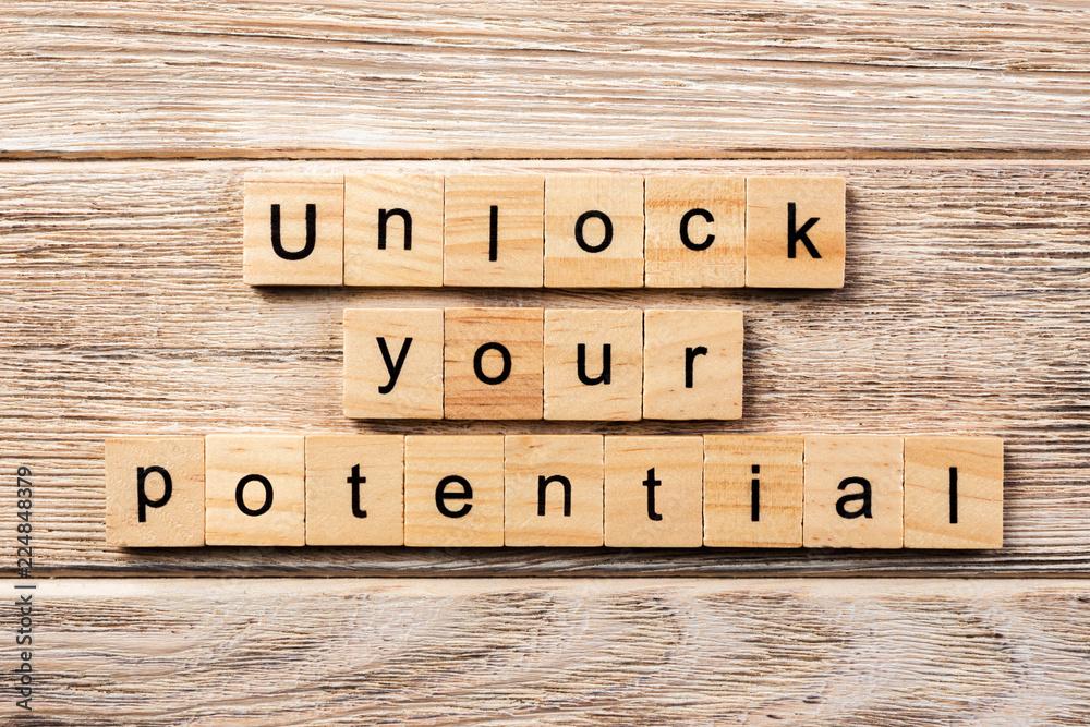 Fototapeta unlock your potential word written on wood block. unlock your potential text on table, concept