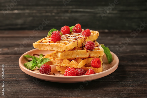 Recess Fitting Appetizer Plate with delicious waffles and raspberries on wooden background