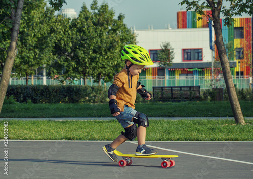 A little boy enjoys a yellow cruiser penny plastboard