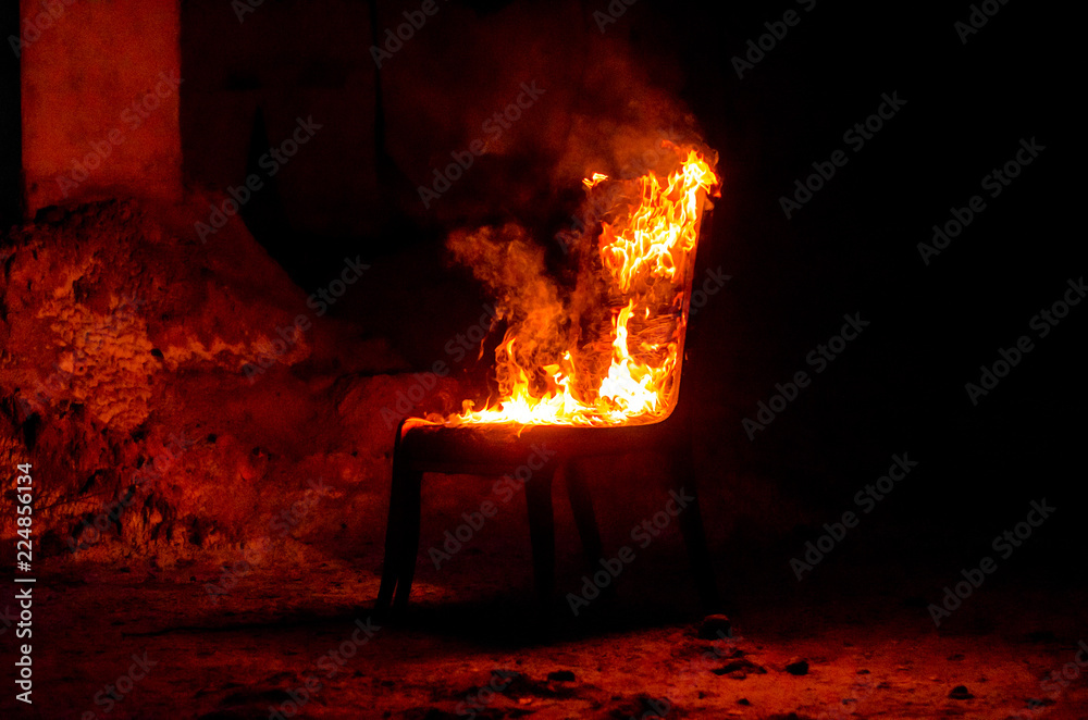 Fototapety, obrazy: Wooden chair is on fire. Incineration of furniture. Conceptual photo, burnout