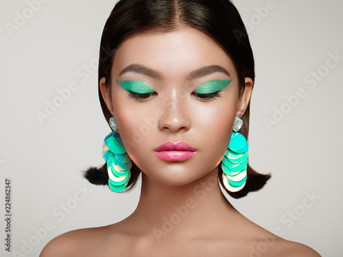 Fotografie, Obraz  Beautiful Korean Woman with Large Turquoise Earrings