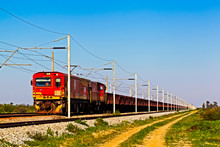Red Electric Narrow Gauge Locomotive And Train
